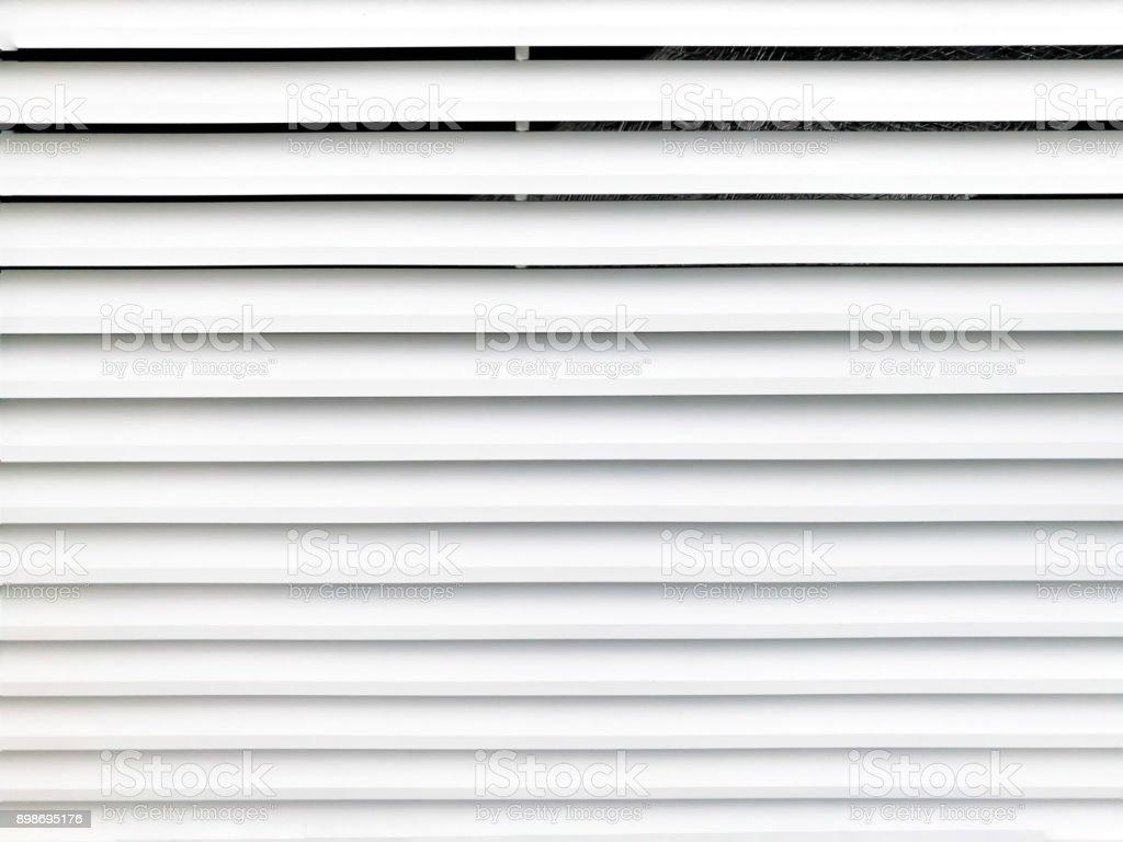 White metal air ventilation grid texture. stock photo