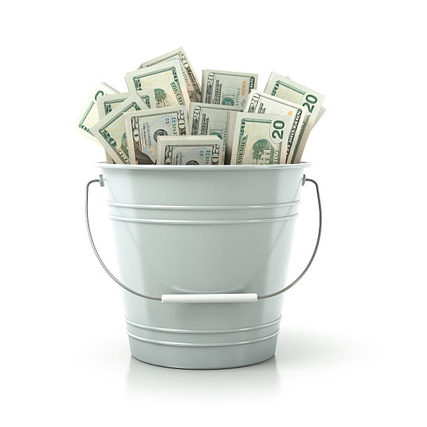 White metal bucket full of money stock photo