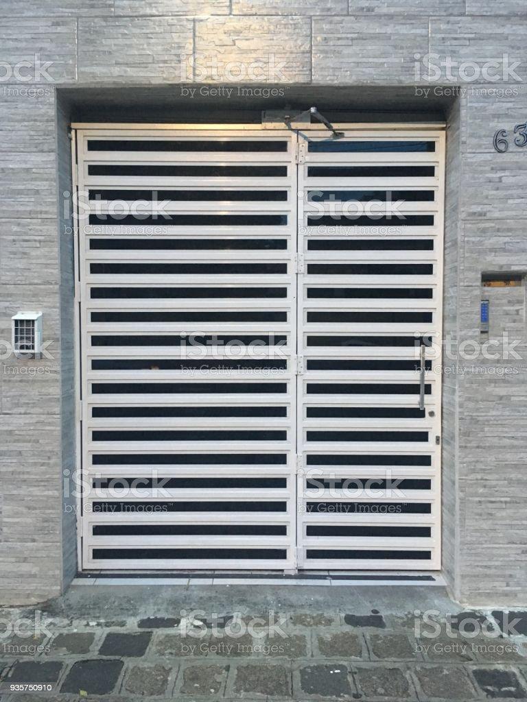 White Metal Grate Front Door   Stock Image .