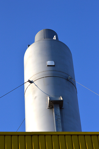white metal silos on yellow base
