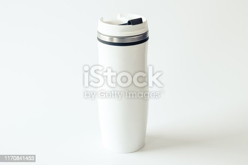 1129148925istockphoto White metal travel mug with a place for your design on white background. Isolated. Mockup. Close up. 1170841453