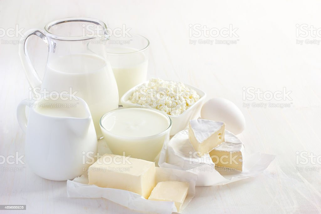 White milk and other dairy products on white background stock photo
