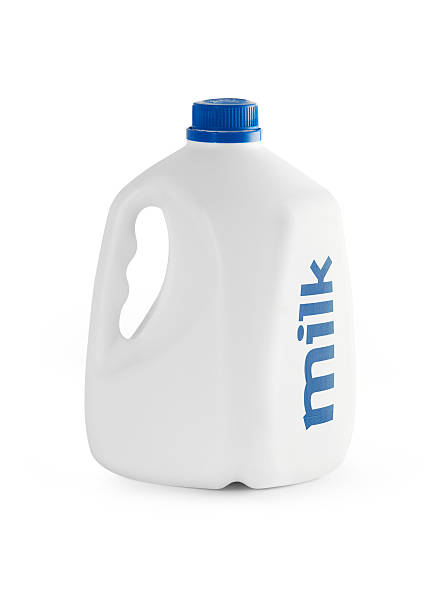 White milk carton with blue writing Milk bottle isolated with clipping path. gallon stock pictures, royalty-free photos & images