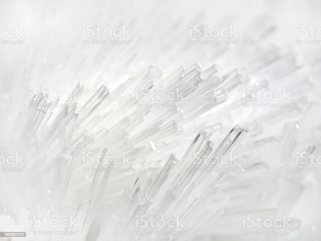 White mineral crystals cluster. Macro image of  Quartz needle crystal cluster on rock matrix, tubular structure. White textured and background stock photo