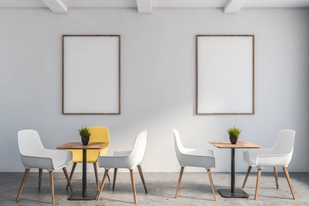 White minimalist cafe interior with poster stock photo
