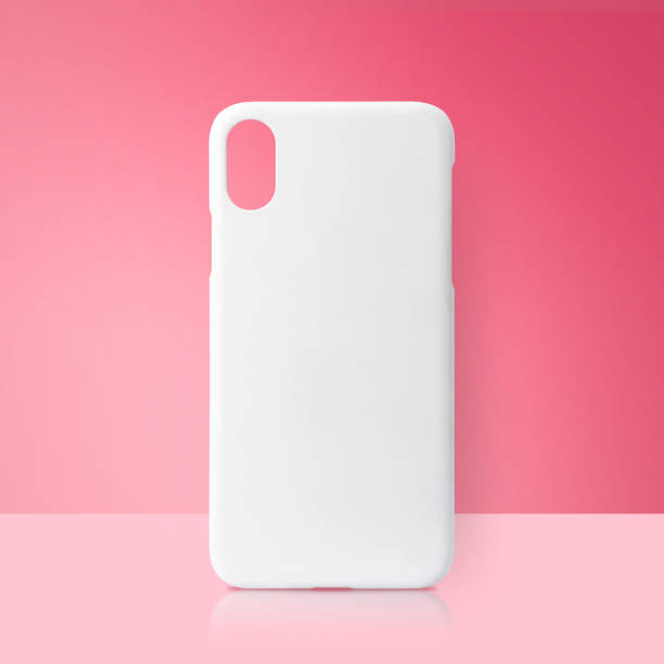 White mobile cover on pink backdrops. Blank phone case for printing. stock photo