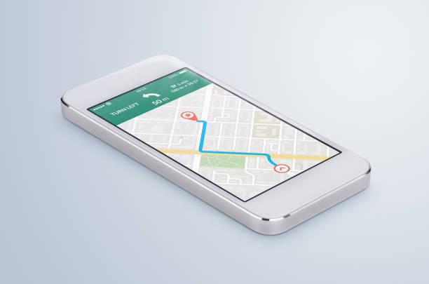 weiße mobile smartphone mit gps-navigations-app karte liegt auf der oberfläche - kompass wanderkarte stock-fotos und bilder
