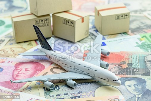 istock White model airplane lands on banknotes. 675822900