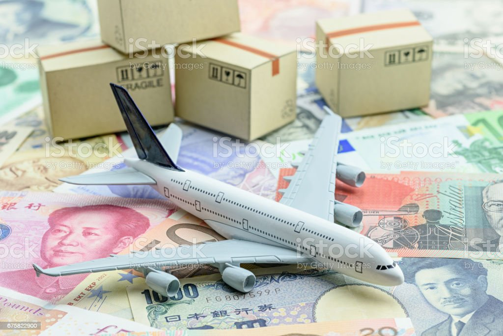 White model airplane lands on banknotes. stock photo