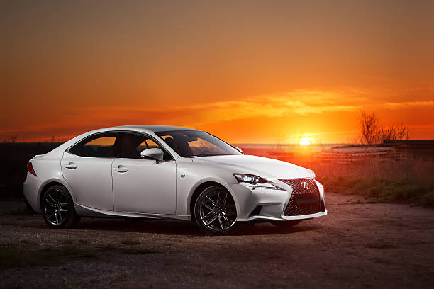 White modern car Lexus stay on road at beautiful sunset stock photo