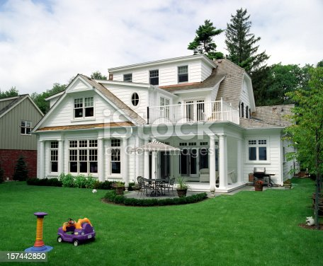 istock White modern house with patio and front lawn 157442850