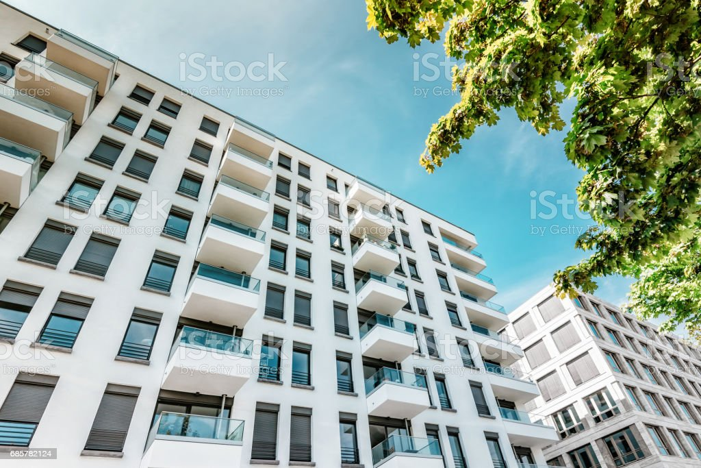 white modern residential houses in berlin with summer sun royalty-free stock photo
