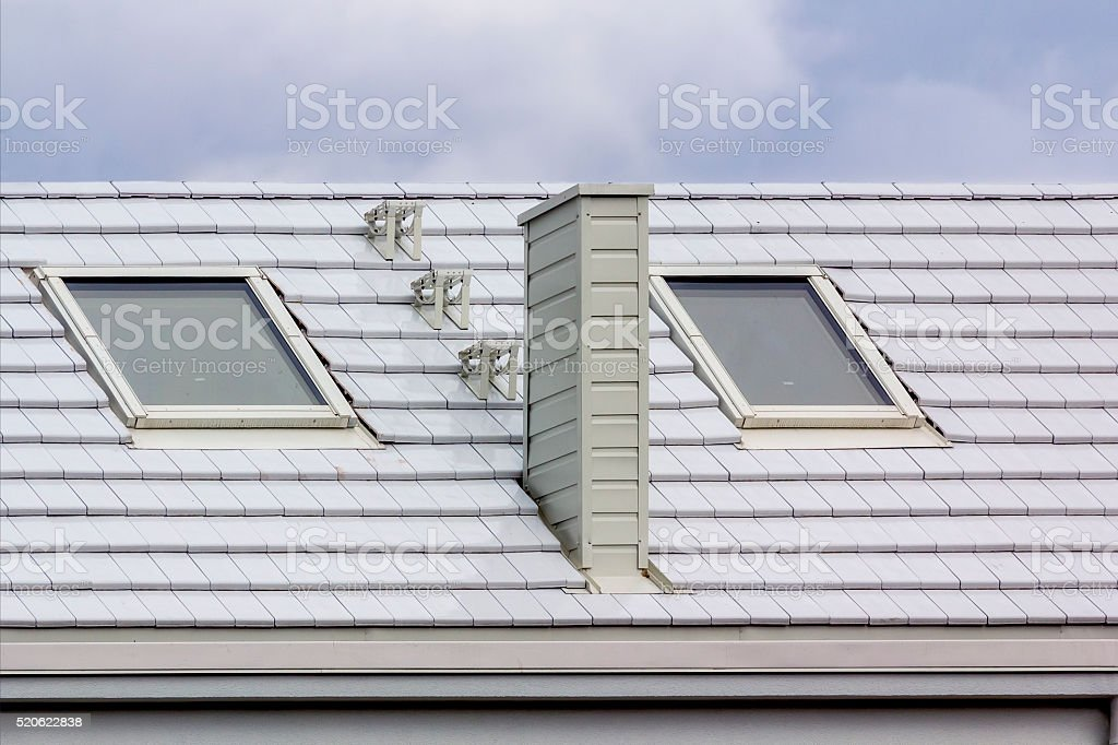 White modern roof with skylight stock photo
