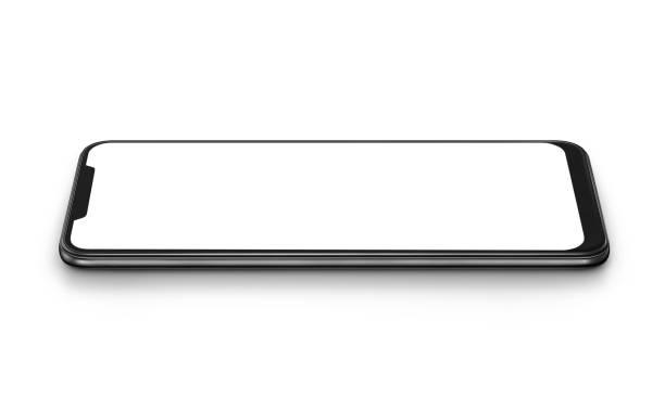 weißes modernes smartphone mit leerem bildschirm liegt auf der oberfläche, isoliert auf weißem hintergrund. - winkel stock-fotos und bilder