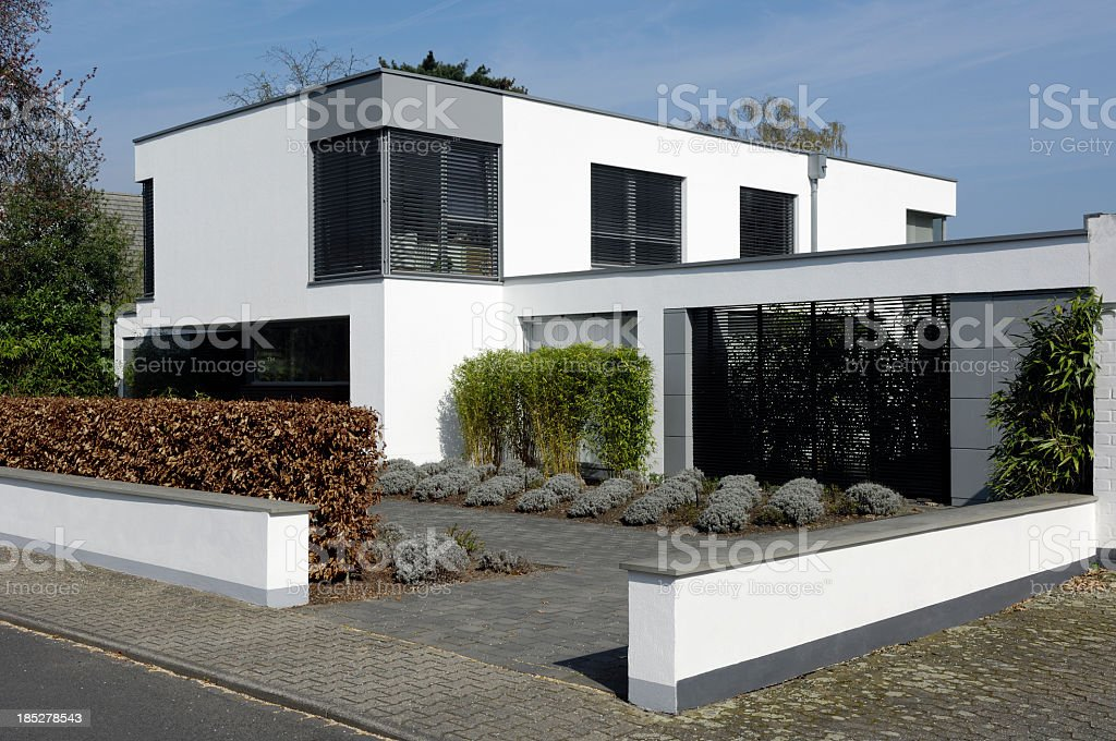 White modern styled home with landscaping stock photo
