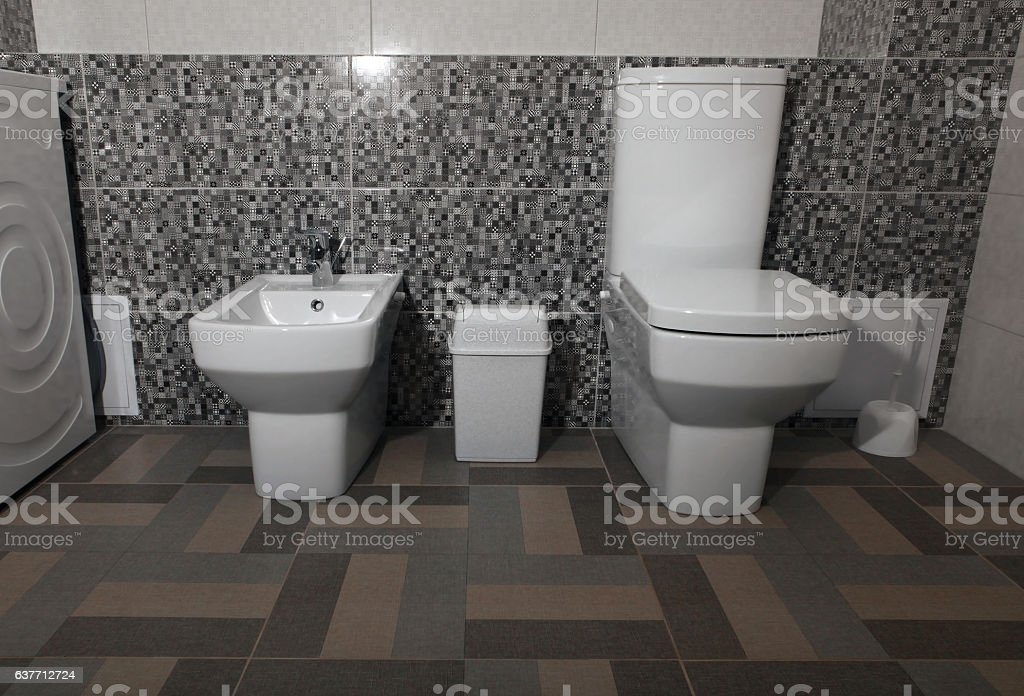 white modern toilet and bidet stock photo