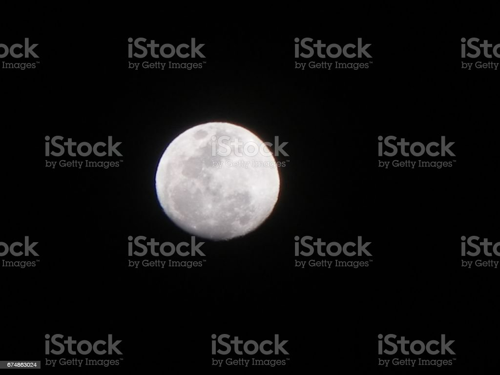 White Moon, Dark Sky stock photo