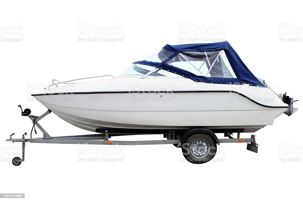 White motor boat with a blue awning. stock photo