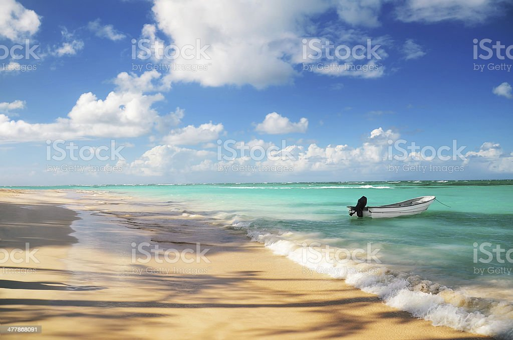 White motorboat at Punta Cana beach stock photo