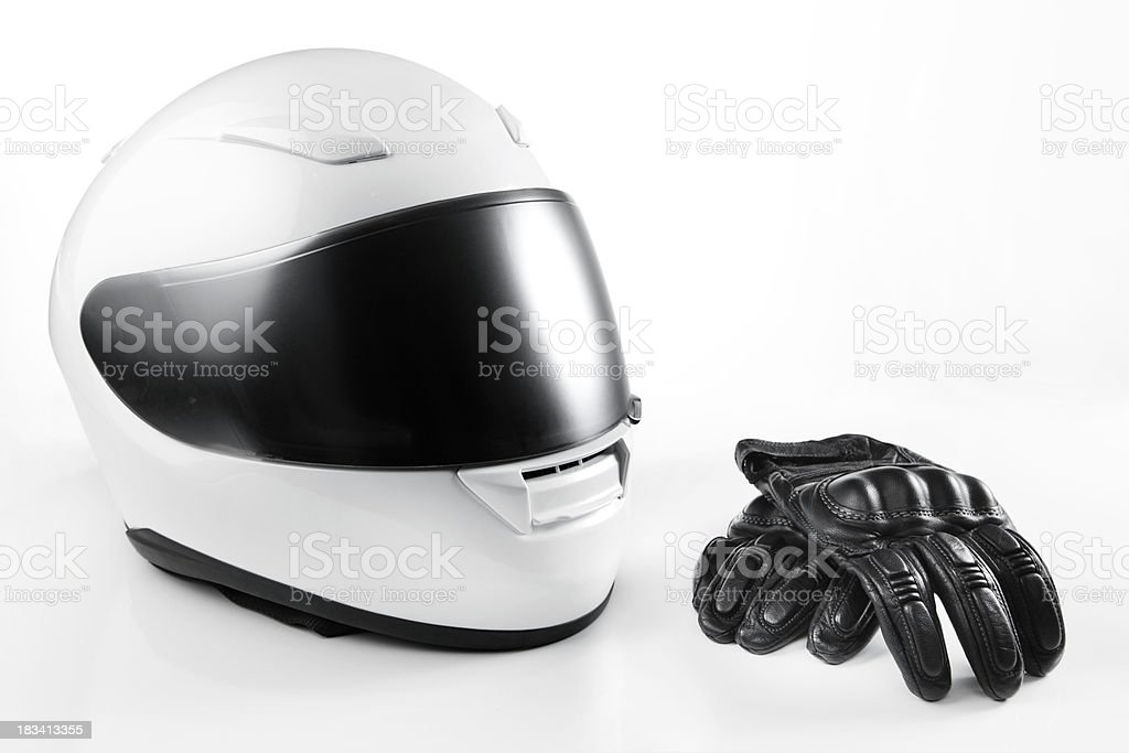 White Motorcycle Helmet and Leather Gloves stock photo