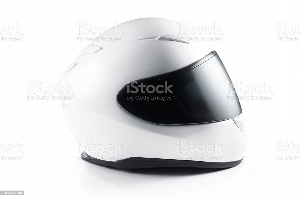 A white motorcycle helmet on a white background stock photo