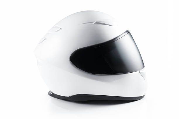 A white motorcycle helmet on a white background white helmet on white background. crash helmet stock pictures, royalty-free photos & images