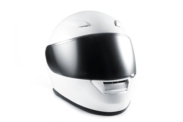 White motorcycle helmet with black visor on white background white helmet on white background. crash helmet stock pictures, royalty-free photos & images