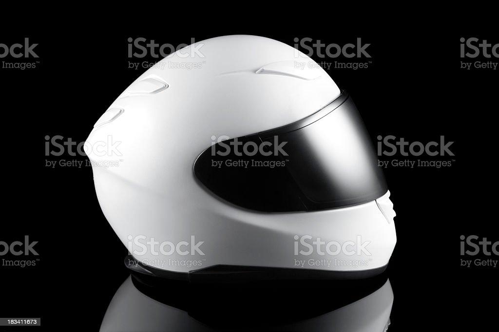 White motorcycle helmet with black visor royalty-free stock photo