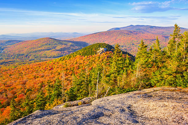 White Mountains in Autumn New Hampshire USA Landscape photo of the White Mountains,  part of the Appalachian Mountains, during Fall colors in New Hampshire, New England, USA. white mountain national forest stock pictures, royalty-free photos & images
