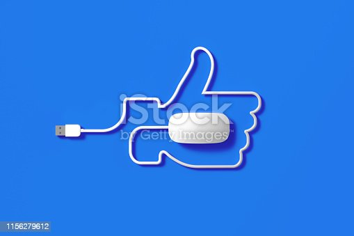 White mouse cable forming a thumps up symbol on blue background. Horizontal composition with copy space.