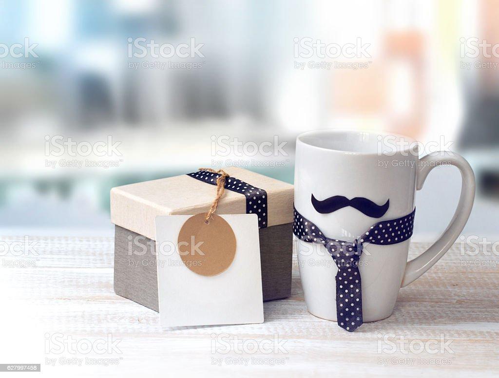 White mug mustache gift box fathers day concept. stock photo