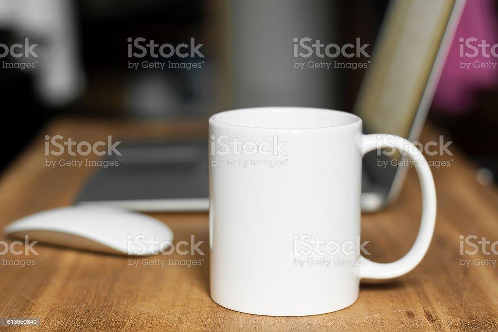 White mug on the desktop stock photo