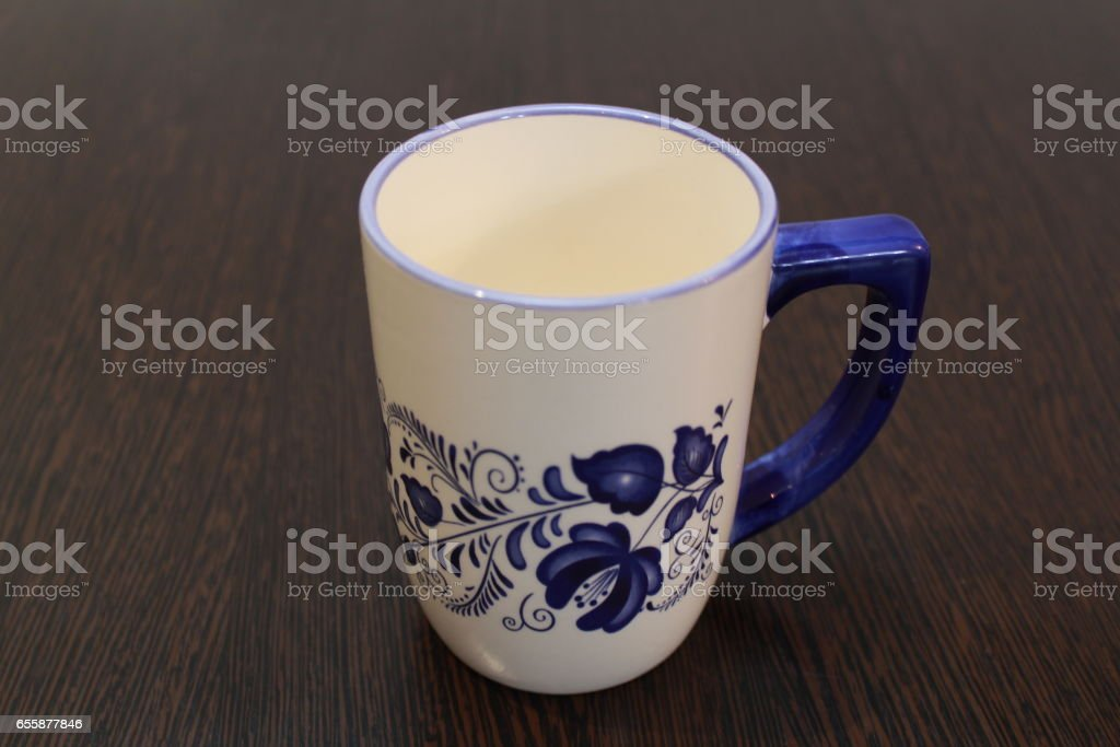 White mug with a blue pattern stock photo