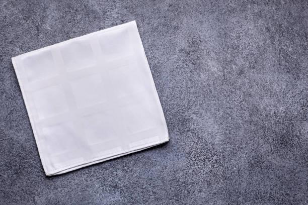 Cтоковое фото White napkin on gray
