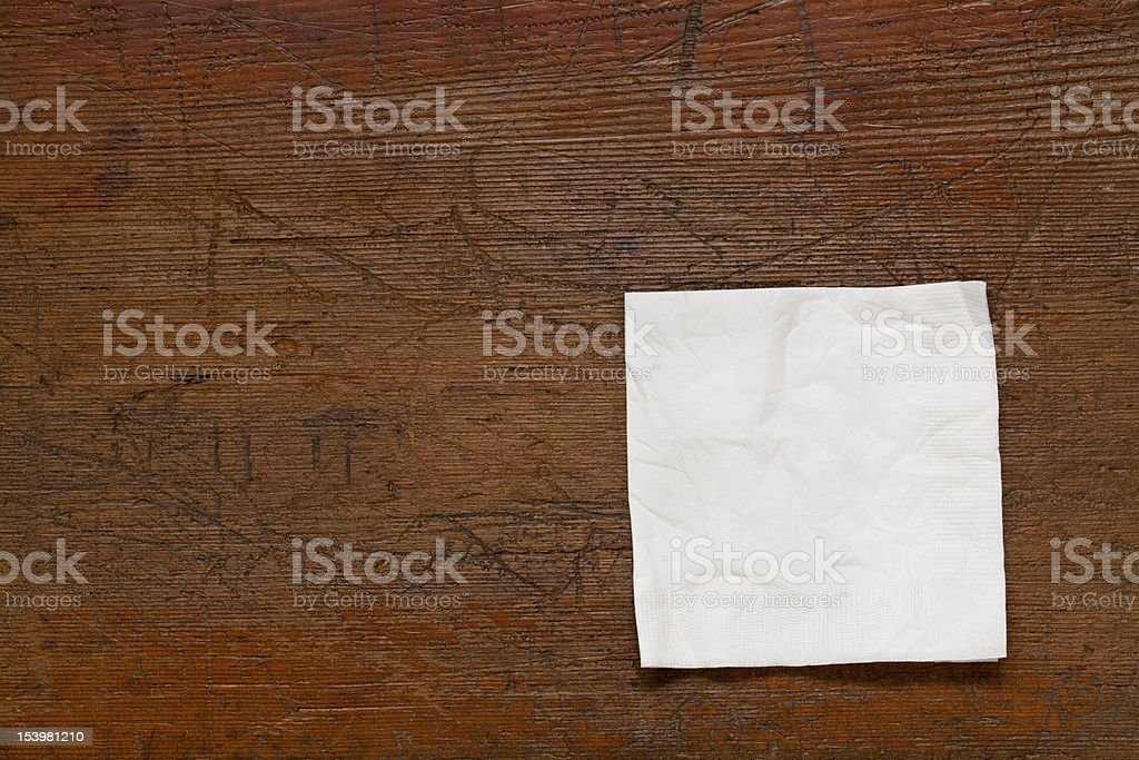 white napkin on wood table stock photo