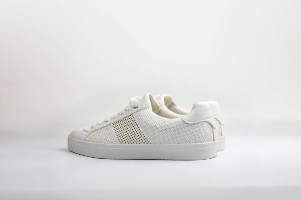 White, new and clean sneaker shoes on white background stock photo