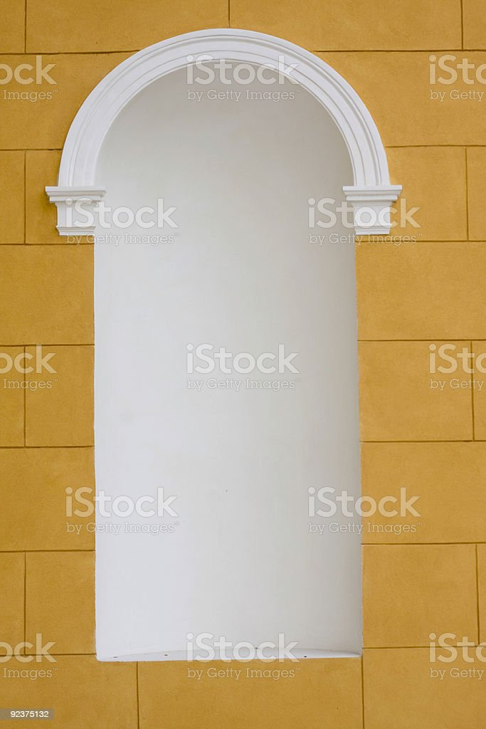 white niche in a peach wall royalty-free stock photo