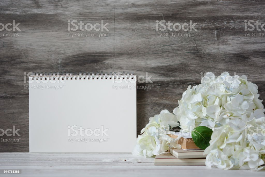White Notebook For Quotes With White Hydrangea Bouquet On The