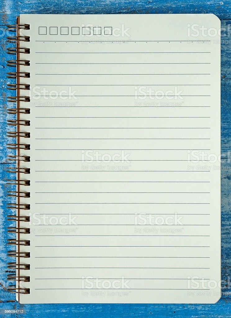 white notebook on blue wooden floor. Lizenzfreies stock-foto