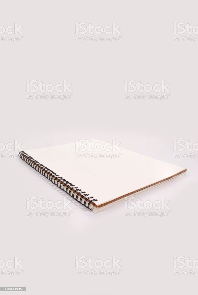 White notebook. Notebook isolated on white background. Advertisement Stock Photo