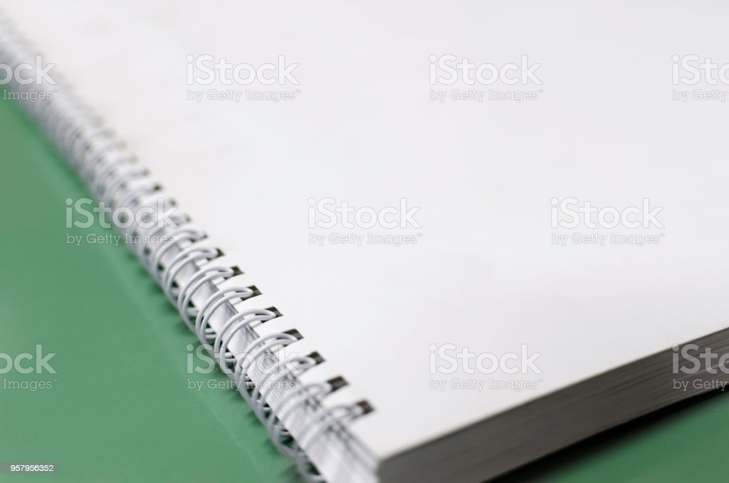 White notebook with spiral, selective focus dof background, office concept - foto stock