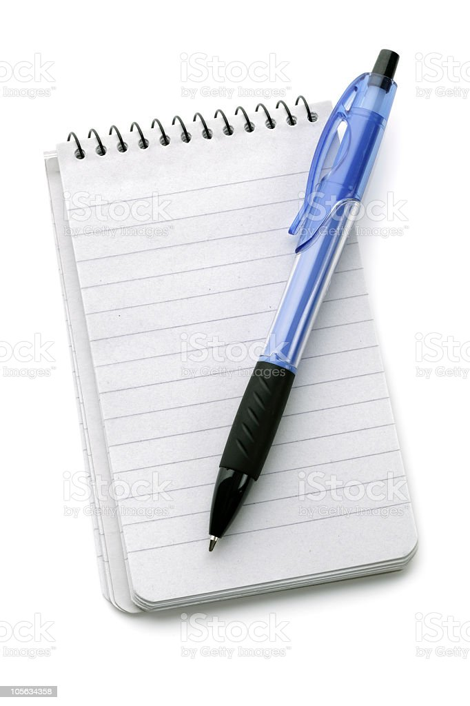 White notepad and a blue ballpoint pen royalty-free stock photo