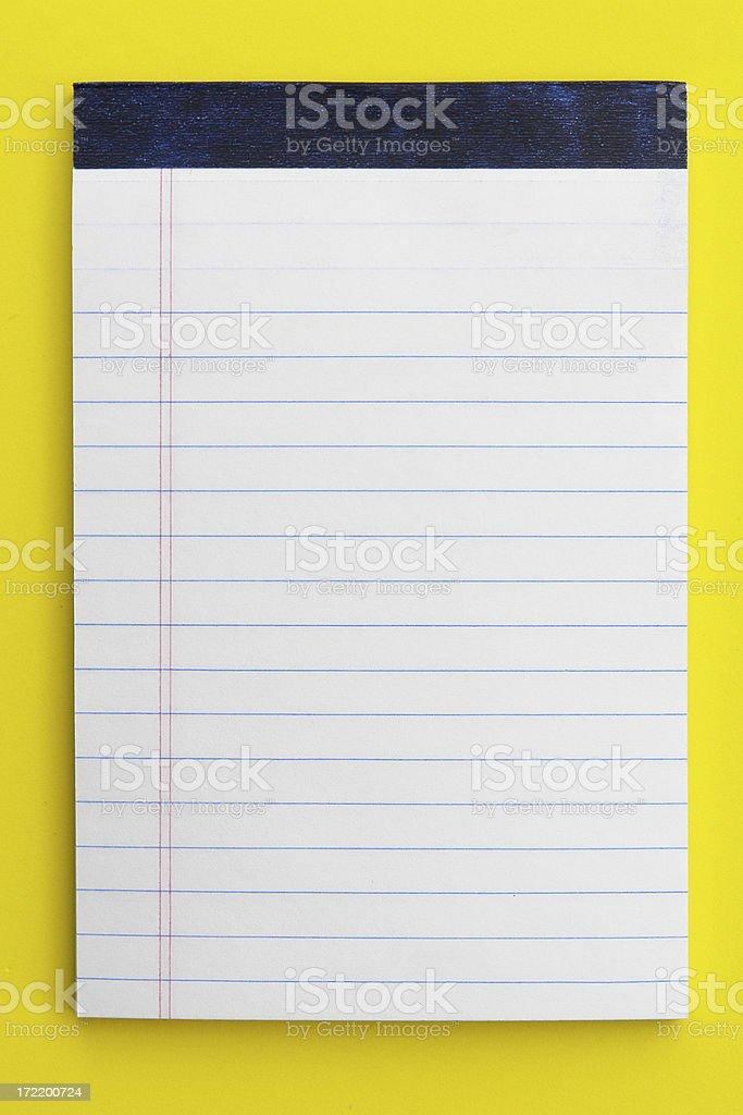 White notepad on foam yellow background stock photo