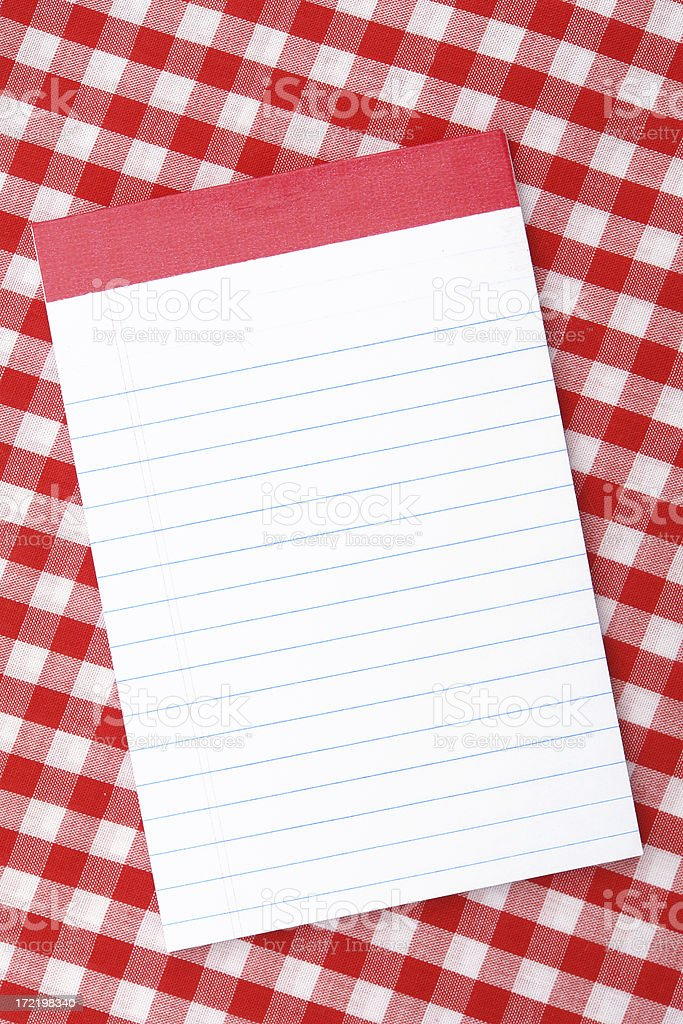 White notepad on red tablecloth royalty-free stock photo