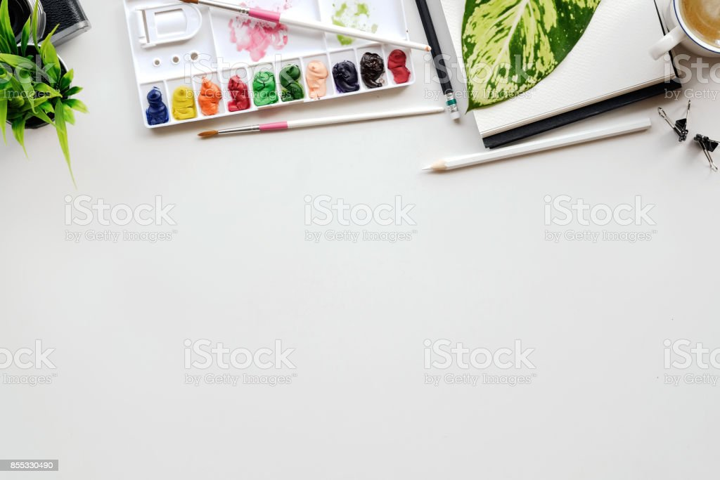White office desk table with a lot of things on it. Top view with copy space. stock photo