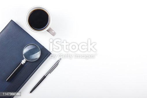 615494694 istock photo White Office desk table with computer, pen and a cup of coffee, lot of things. Top view with copy space. 1147366160