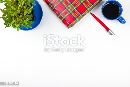 615494694 istock photo White Office desk table with computer, pen and a cup of coffee, lot of things. Top view with copy space. 1147366196