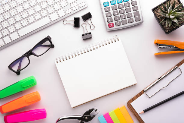White office desk table with school accessories with office supplies. Top view with copy space White office desk table with school accessories with office supplies. Top view with copy space office equipment stock pictures, royalty-free photos & images