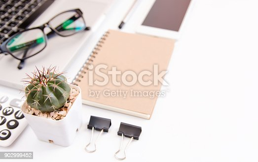 604021340 istock photo White office desk table, workspace office with laptop, smartphone black screen,pen,calculator, glasses, Top view with copy space 902999452