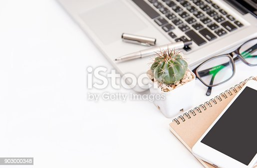 604021340 istock photo White office desk table, workspace office with laptop, smartphone black screen,pen,calculator, glasses, Top view with copy space 903000348